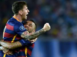 Alves and Messi pictured as Barcelona team-mates. AFP
