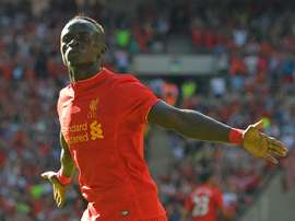 Liverpools midfielder Sadio Mane celebrates after scoring the opening goal of the pre-season International Champions Cup against Barcelona at Wembley stadium on August 6, 2016