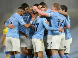Manchester City celebrate Phil Fodens goal against Brighton. AFP