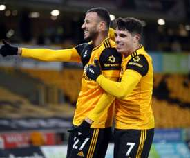 Romain Saiss (L) got Wolves a deserved draw at home to Tottenham. AFP