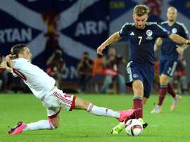 James Morrison (R) of Scotland vies for the ball with Jano Ananidze (L) of Georgia during their Euro 2016 qualifying football match in Tbilisi on September 4, 2015