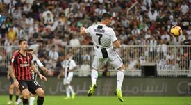 Cristiano Ronaldo rises to head home his 16th goal of the season. AFP