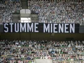 Gladbach's cardboard fans saw their side lose against Leverkusen. AFP