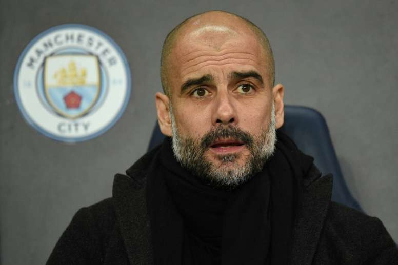 Guardiola fined by FA over yellow ribbon protest. AFP