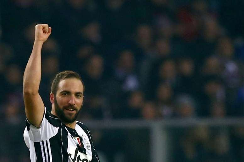 Juventus forward Gonzalo Higuain answers his critics with a goal against Torino at the Grande Torino Stadium