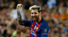 Messi celebrating a goal for Barca. AFP