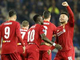 Liverpool, Chelsea win on road as Messi, Mertens and Haaland set goals records. AFP