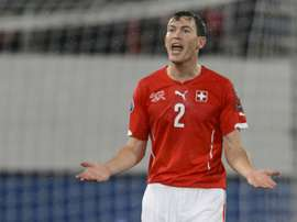 Lichtsteiner says his move to Arsenal is not yet complete. AFP
