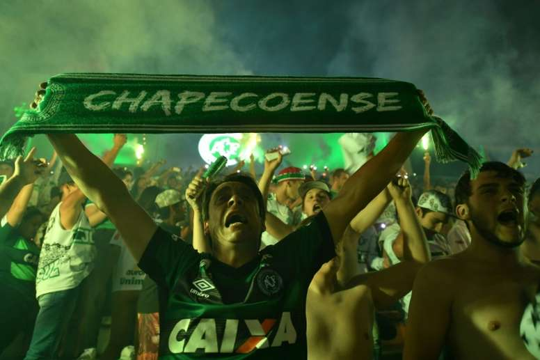 Brazils Chapecoense football club fans participate in a tribute to the players killed in the LaMia airlines plane crash at the clubs stadium in Chapeco, Santa Catarina, Brazil, on November 30, 2016