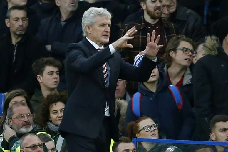Southampton have reportedly approached former Stoke City boss Mark Hughes. AFP