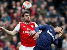 Sokratis Papastathopoulos (L) has left Arsenal six months earlier than planned. AFP