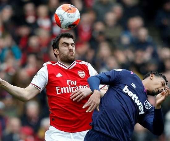 Sokratis Papastathopoulos (L) has left Arsenal six months earlier than planned. AFP