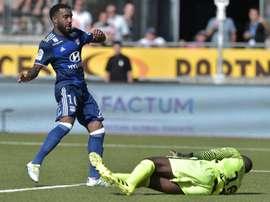 Alexandre Lacazette (L) scores for Lyon. AFP