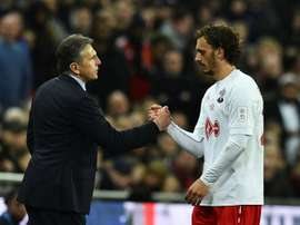 Southampton's manager Claude Puel shakes hands with striker Manolo Gabbiadini. AFP