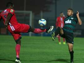 Ass Madaw Sy and Mouloudia Bejaias Morgan Betorangal in action during the CAF Confederation Cup. AFP