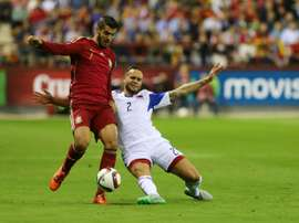 Spains forward Alvaro Morata (L) vies with Luxembourgs defender Maxime Chanot during the Euro 2016 qualifying football match Spain vs Luxembourg at Las Gaunas stadium in Logrono on October 9, 2015