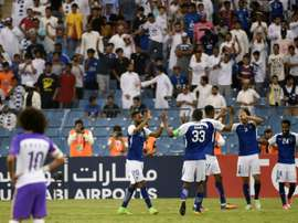 Al Hilal's players celebrate after overcoming Al-Ain on Monday. AFP
