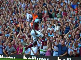 West Ham Uniteds Senegalese midfielder Cheikhou Kouyate celebrates in front of supporters during the English Premier League football match between West Ham United and Bournemouth in Upton Park, East London on August 22, 2015