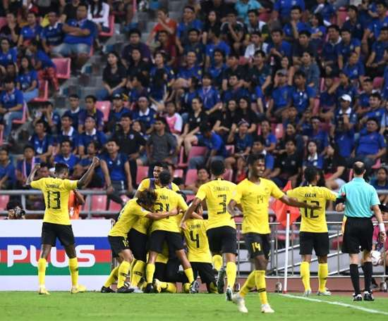 The away supporters were soon celebrating as Malaysia drew level before the half-hour. AFP