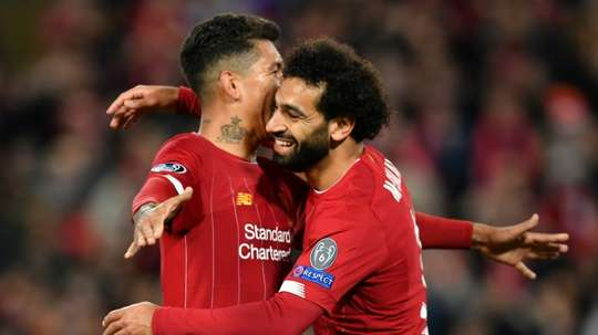 Mohamed Salah (right) came to the rescue with the winner in a 4-3 victory over Salzburg. AFP