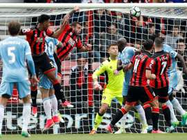 Two own goals as Bournemouth ensure safety