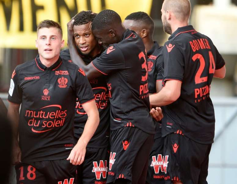 Nices players celebrate after scoring against Nancy. AFP