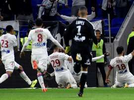 Lyons French forward Nabil Fekir (R) celebrates with teammates after scoring a goal