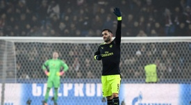 Arsenal's forward Lucas Perez (R) celebrates his third goal during the UEFA Champions league. AFP