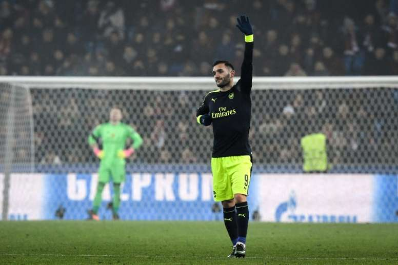 Arsenal's forward Lucas Perez (R) celebrates his third goal during the UEFA Champions league. AFP