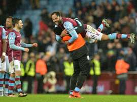 Aston Villas defender Joleon Lescott (top) celebrates after winning the match between Aston Villa and Crystal Palace at Villa Park in Birmingham, on January 12, 2016