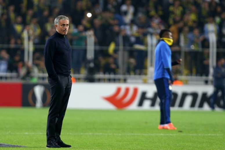 Mourinho standing on the pitch. AFP