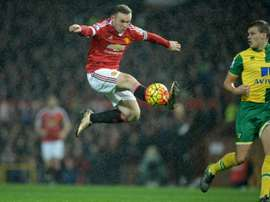 Manchester Uniteds English striker Wayne Rooney controls the ball during the English Premier League football match between Manchester United and Norwich City at Old Trafford in Manchester, north west England on December 19, 2015