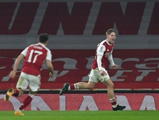 Emile Smith-Rowe (R) scored for Arsenal in extra-time. AFP