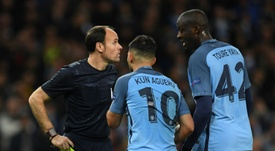 Manchester City midfielder Yaya Toure and striker Sergio Aguero remonstrate with the referee. AFP