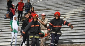 Emergency personnel carry an injured supporter at the Mohammed V Stadium in Casablanca. BeSoccer