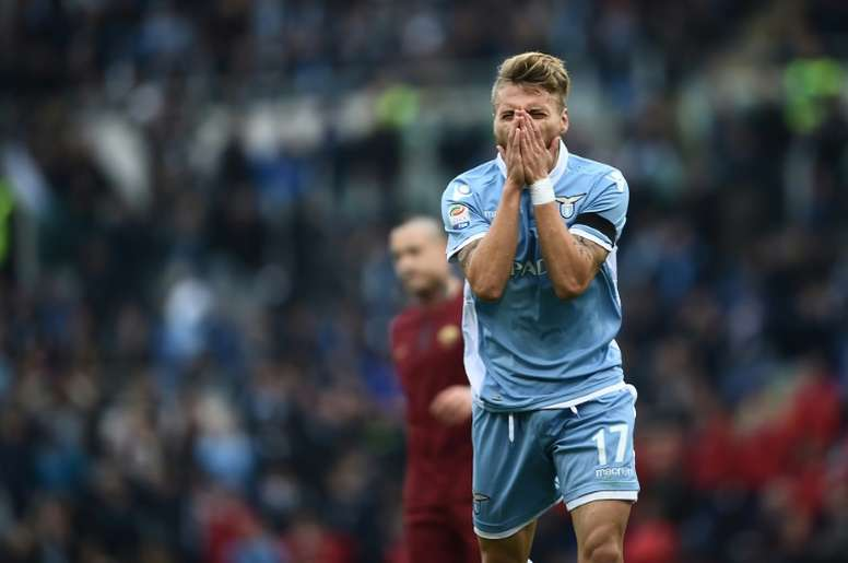 Lazios forward from Italy Ciro Immobile reacts during the Italian Serie A football match SS Lazio vs AS Roma on December 4, 2016