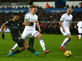 City e Swansea, frente a frente neste domingo. AFP
