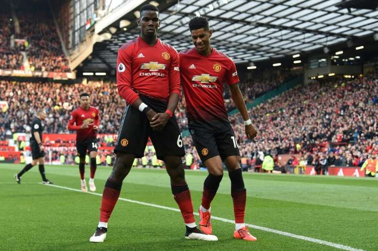 Manchester United could have Paul Pogba (left) and Marcus Rashford (right) fit for when the Premier League returns