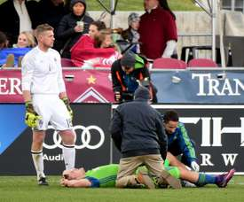 Jordan Morris of Seattle Sounders receives attention from staff in front of goaltender Zac MacMath of Colorado Rapids after an injury during his goal for a 1-0 lead at Dicks Sporting Goods Park on November 27, 2016