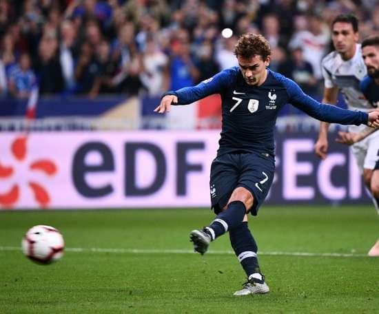 Griezmann's second hands France the three points. AFP