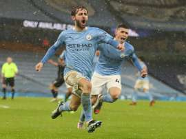 Man City move into first place after late show sinks Villa. AFP