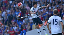 Pape Souare (left) and Son Heung-Min compete for the ball during Sunday's game