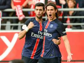 Paris Saint-Germains forward Edinson Cavani (R) is congratulated by his teammate on scoring during a French Ligue 1 football match against Reims on September 19, 2015 at the Auguste Delaune stadium in Reims