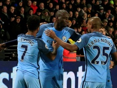 Manchester Citys Yaya Toure (C) celebrates scoring a goal during their English Premier League match against Hull City, at the KCOM Stadium in Kingston upon Hull, on December 26, 2016