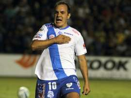 Cuauhtemoc Blanco, pictured celebrating after scoring for Puebla on September 12, 2014, retired from football in April before diving into politics