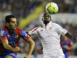 Levantes defender Angel Trujillo (L) vies with Sevillas French forward Gael Kakuta during the Spanish league football match at the Ciutat de Valencia stadium in Valencia on September 11, 2015