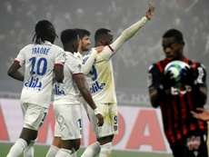 Ten-man Lyon beat Nice to move fifth in Ligue 1. AFP