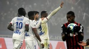 Ten-man Lyon beat Nice to move fifth in Ligue 1. AFP