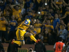 Andre-Pierre Gignac of Tigres of Monterrey celebrates after scoring a penalty against Pumas during the first leg of the Mexican Apertura 2015 tournament final match, at the Universitario stadium in Monterrey, on December 10