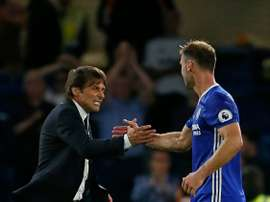 Ivanovic (R) believes that Chelsea didn't deliver for Conte. AFP